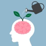 Watering can pouring water onto a head and the brain is sprouting new, green leaves