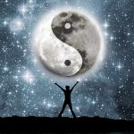 Silhouette of a person gazing in wonder at the universe with a Yin/Yang symbol in the stars